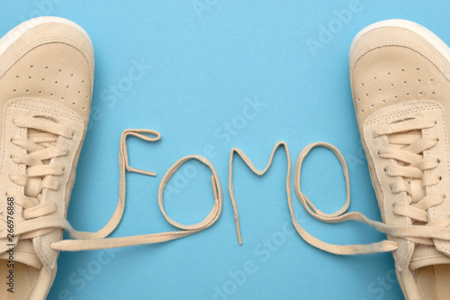 Laces invfomovtext. Fear of missing out concept Tablou Canvas
