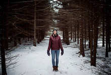 Woman Standing In Forest During Winter