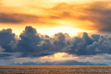 Sun Rays At Sunrise Above Mountains And Sea, Norway