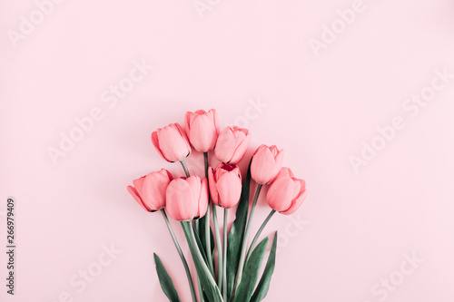 Spoed Foto op Canvas Tulp Beautiful composition spring flowers. Bouquet of pink tulips flowers on pastel pink background. Valentine's Day, Easter, Birthday, Happy Women's Day, Mother's Day. Flat lay, top view, copy space