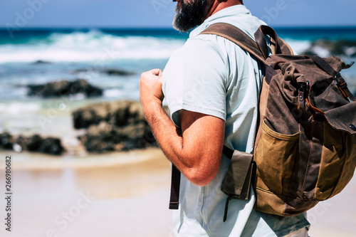 Fotografia  Close up of adult people caucasian man travel with leather style backpack - alte