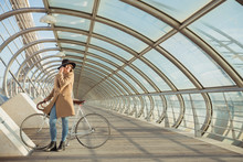Young Hipster Woman With A Bicycle In A Modern Tunnel