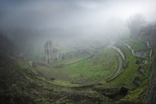 From Above View Of Mossy Green Ruins In Heavy Fog, Italy