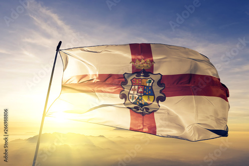 Huesca province of Spain flag waving on the top sunrise mist fog
