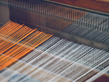 Cotton Threads Of Orange And White Color On Industrial Loom On Fabric Factory