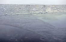 Ice On Frozen Lake / Pond, Small Patches Of Snow On Flat Surface