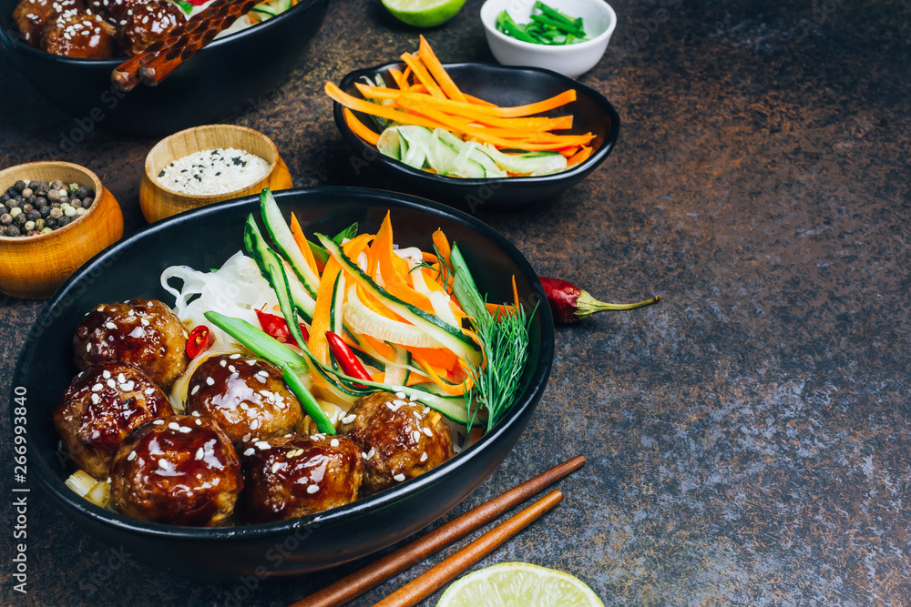 Fototapety, obrazy: Meatballs with teriyaki souce, rice noodle, vegetables and sesame seeds
