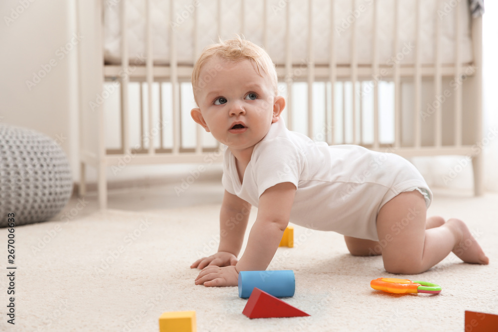 Fototapety, obrazy: Cute little baby crawling on carpet indoors