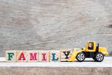 Toy Bulldozer Hold Letter Block Y To Complete Word Family On Wood Background