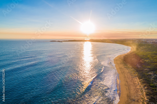 Sunset over coastline - aerial view