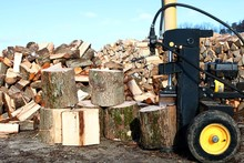Yellow And Black Log Splitter On End To Split Vertically With Blocks, Heap And Woodpile