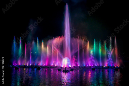 The colorful fountain dancing in celebration festival with dark night sky background Wallpaper Mural