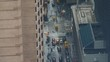 CLOSE UP: Cars drive down the wet road on a gray and rainy day in New York. Cars and yellow taxis drive down the wet asphalt road under the towering skyscrapers in Manhattan. Gray streets of NYC.