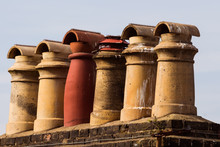 Old Chimneys Of A Roof Of An O...