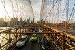 Traffic in rush hour after working day on the Brooklyn bridge over New York cityscape background with sunset, USA, United States, Business and transportation concept