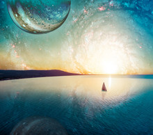 Dreamy Fantasy Landscape Of Lone Sailboat Sailing At Sunset Near Coastline. Elements Of This Image Furnished By NASA