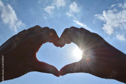 Fotografia  Heart shape with sun