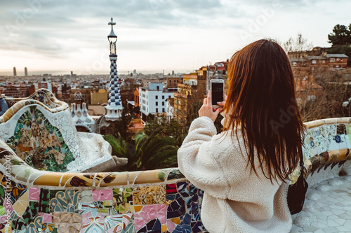 Poster Barcelona Barcelona signature style. modern tourist woman in coat at Guell Park in Barcelona