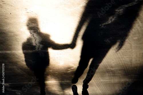 Shadow silhouettes of father and son walking hand in hand Wallpaper Mural