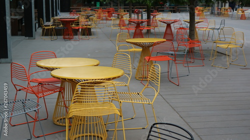 Outdoor tables and chairs in a seated alfresco dining area Canvas Print