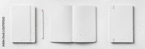 Obraz white notebook isolated on white background - fototapety do salonu