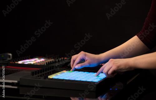 Dj hand remixing music on midi controller  - 267051671