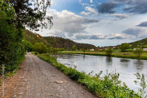 Fotografie, Obraz  View of picturesque landscape of green hill and Berounka river