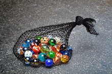 Bag Of Multicolored Marbles On...