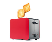 Roasted Toast Bread Popping Up Of Red Toaster, Isolated On White Background. File Contains A Path To Isolation.