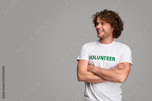 Confident volunteer looking away