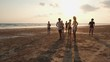 Asian teen group walk and run together at seaside beach summer with sunset background. Young asia happy emotion and anniversary celebration. 4K resolution and slow motion.