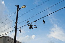 A Lot Of Shoes Hanging From Th...