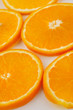 Fresh slised oranges isolated on the gray background