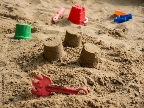 Fotografie, Obraz Children sandbox with plastic toys side view