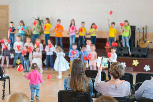Performance by talented children. Children on stage perform in front of parents. image of blur kid 's show on stage at school , for background usage. Blurry - 267091019