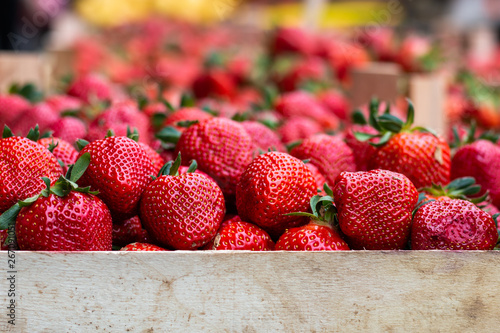 Fresh ripe strawberries in wooden basket ready for sale on the marketplace in Belgrade. Space for your text - 267091051