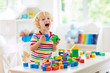 canvas print picture Kids toys. Child building tower of toy blocks.