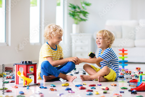 Stampa su Tela Kids play with toy cars. Children playing car toys
