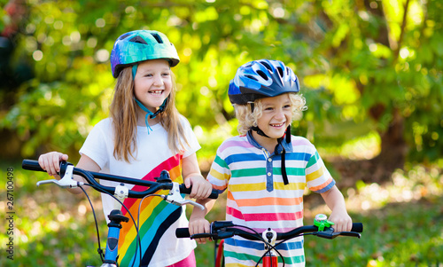 fototapeta na ścianę Kids on bike. Children on bicycle. Child biking.