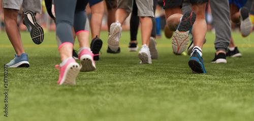 Fotografie, Obraz  Running children, young athletes run in a kids run race, running on grass detail