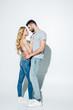Leinwandbild Motiv handsome man hugging attractive blonde girl in lace bra on white