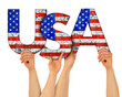 canvas print picture people arms hands holding up wooden letter lettering forming words united states of america USA stars spangled banner national flag colors tourism travel elections concept isolated white background