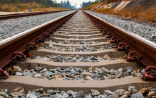 Close Up Of Iron Railroad And Concrete Railroad Sleeper Or Railroad Tie.