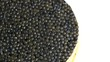 Caviar closeup. Black caviar rotated on white background. High quality natural sturgeon caviar close-up, rotation. Delicatessen. 4K UHD video footage 3840X2160
