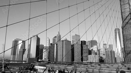 Fototapeten New York Manhattan buildings view from Brooklyn Bridge, black and white, New York, USA