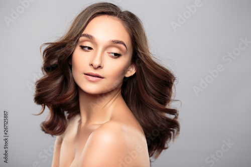 Fototapety, obrazy: Brunette girl with healthy curly hair and natural make up . Beautiful model woman with wavy hairstyle .Care and beauty