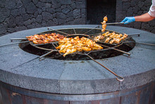 Chicken Legs On The Grill Grill Over The Natural Heat Of A Volcano In The El Diablo Canary Islands National Park. Spain Lanserote
