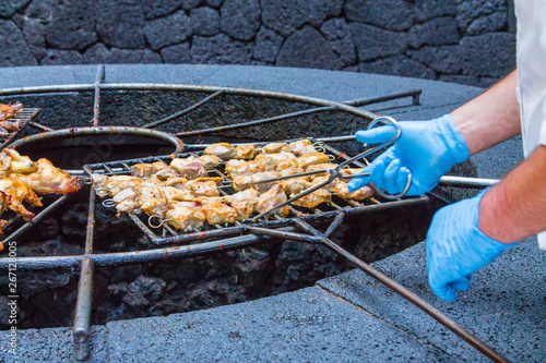 Chicken legs on the grill grill over the natural heat of a volcano in the El Diablo Canary Islands National Park Wallpaper Mural