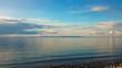 Sunset on Lake Baikal. Evening, rain, clouds, sun. Dramatic sky. Atmospheric landscape. The shore of Lake Baikal. Russia.