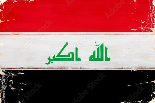 Flaga Iraku malowana na starej desce. Fototapet
